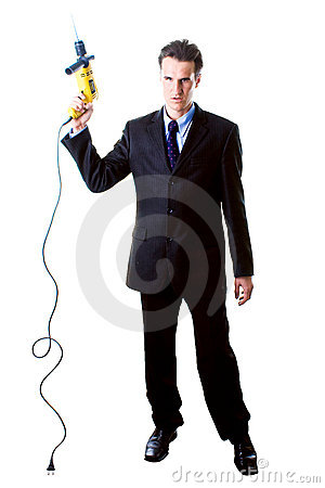 Dread businessman holding drill