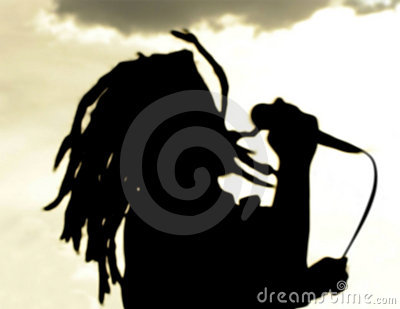 Dreadlock singer silhouette at sunset