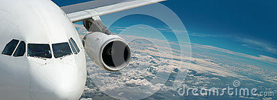 Dream liner of bright travel. Panorama above Earth