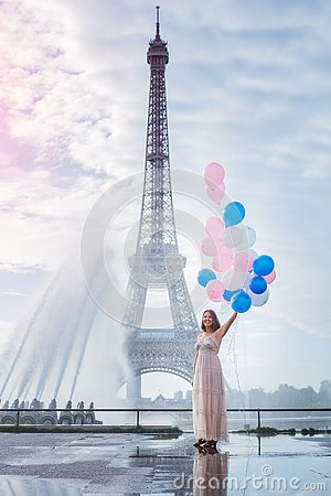 Free Dream Travel - Young Woman With Balloons Walking Near Eiffel Tower In Paris Royalty Free Stock Photography - 145668887