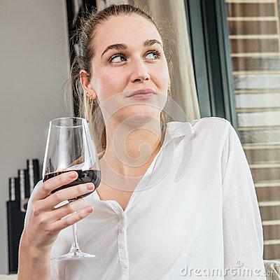Free Dreaming Beautiful Young Woman Enjoying Holding Wine Glass For Degustation Royalty Free Stock Photography - 86673867