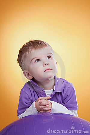 Dreaming cute little boy looking up