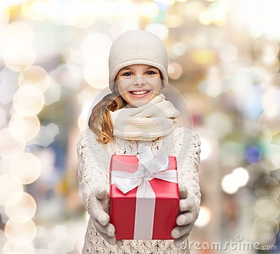 Free Dreaming Girl In Winter Clothes With Gift Box Stock Photos - 44577363
