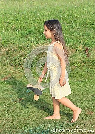 Dreaming girl walking barefoot