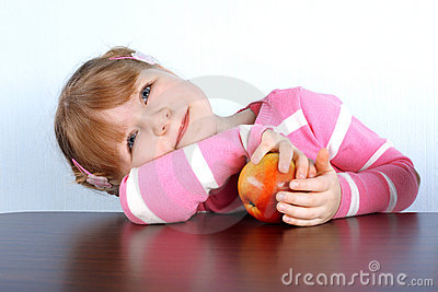 Dreaming little girl with apple