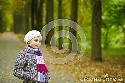 Dreaming nice little girl in park