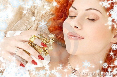 Dreaming redhead with white christmas bells