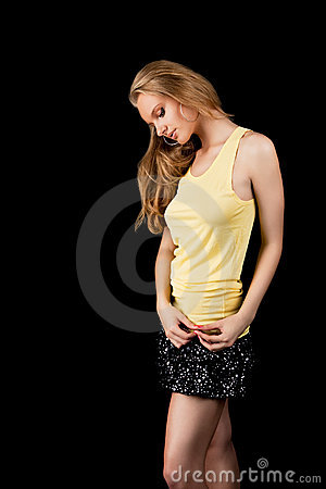 Dreaming sexy young blonde girl with bowed head