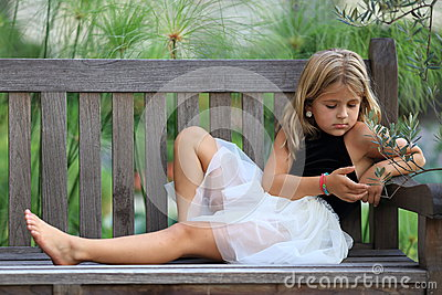 Girl Sitting Alone On Bench Dreaming Royalty Free ...
