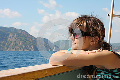 Dreaming young woman on yacht