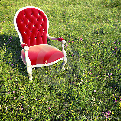 Dreamlike armchair on a meadow
