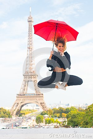 Free Dreams Come True Concept. Lady Tourist Sporty And Active In Paris City Center Jumps Up. Girl Tourist Enjoy Walk And Royalty Free Stock Image - 118189426