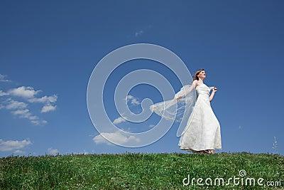 Dreamy beautiful blonde bride walking