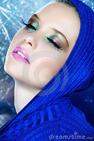 Dreamy beautiful woman in blue