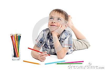 Dreamy child boy with pencils
