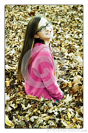 Dreamy Girl in Fall Leaves