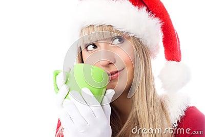 Dreamy girl having a cup of tea