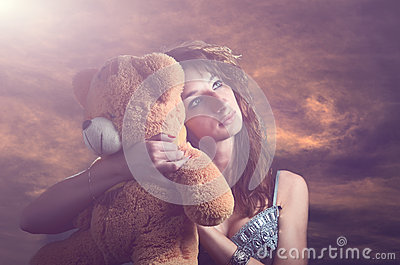 Dreamy girl with a teddy bear