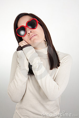 Free Dreamy Girl Wearing Heart-shaped Sunglasses Royalty Free Stock Photography - 17686607