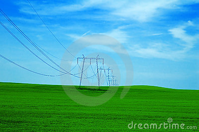 Dreamy grassy hill and powerlines