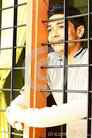 Dreamy Indian Boy Looking Out through the Window