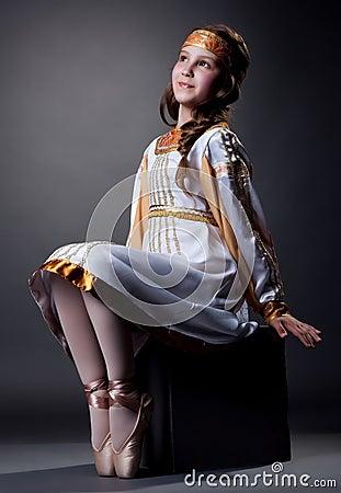 Free Dreamy Little Ballerina Posing In Folk Dress Stock Photos - 52302953