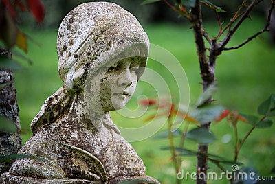 A Dreamy Vintage Aged Garden Statue of Young Girl
