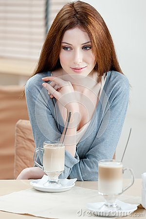 Dreamy woman with milk cocktail