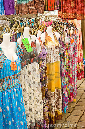 Dresses on market stall.