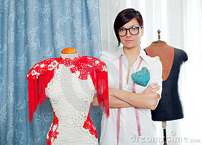Dressmaker with mannequin working at home