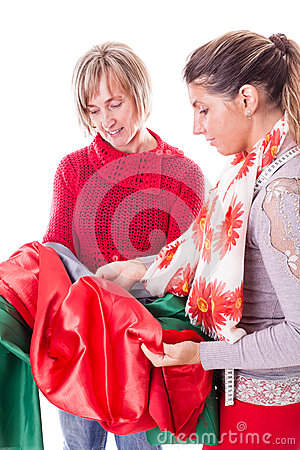 Free Dressmakers Choosing The Fabric Stock Images - 46615494