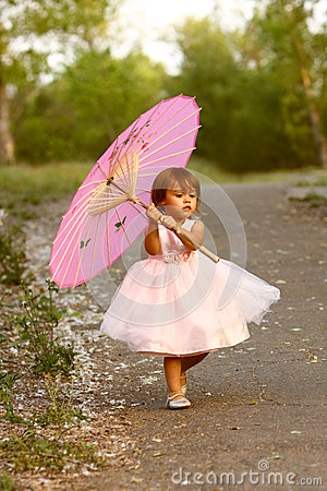 Free Dressy Two-year-old Girl Carrying Pink Parasol Stock Photo - 30439400