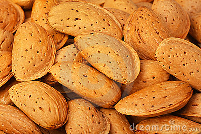 Dried almonds closeup, background