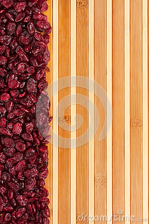 Dried cranberries lying on a bamboo mat