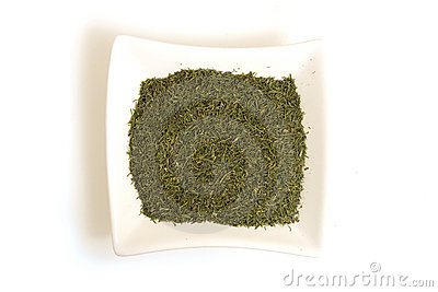 Dried dill in square white bowl