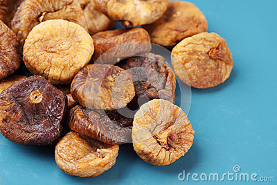 Dried figs on blue plate