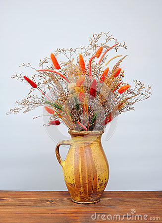 Dried flowers in a ceramic vase