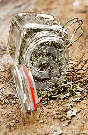 Dried herbs in glass bottle