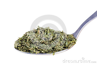 Dried lovage in a spoon