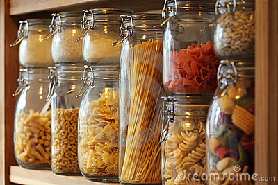 Dried pasta in jars on a shelf