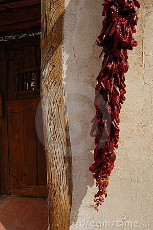 Free Dried Peppers Against Doorway Stock Images - 14160814