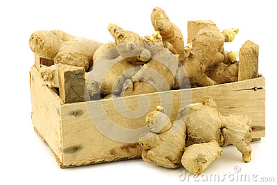 Dried pieces of ginger root in a wooden crate