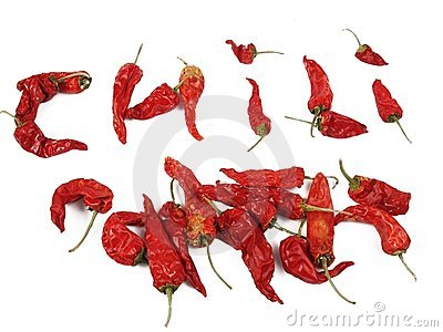 Dried red chilis, some arranged to spell out chili