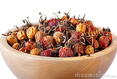 Dried rosehips in wooden bowl