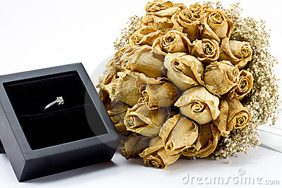Dried roses bouquet and engagement ring