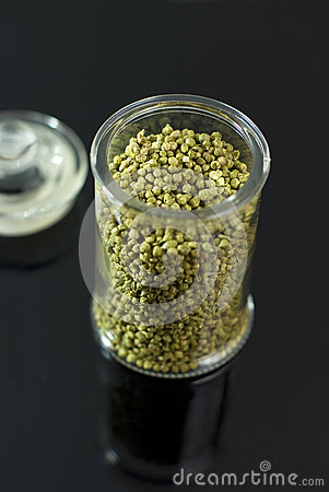 Dried thyme buds in a glass container