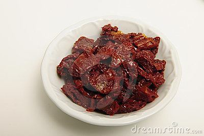 Dried tomatoes in white dish