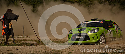 Drifting rally car and a camera operator (wide) Editorial Photo