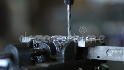 Drill tool in chuck during metal cutting process stock video footage