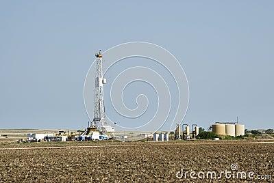 Drilling Rig & gas storage tanks